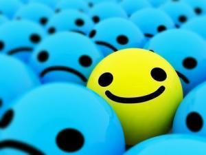 yellow smile in field of blue frowns